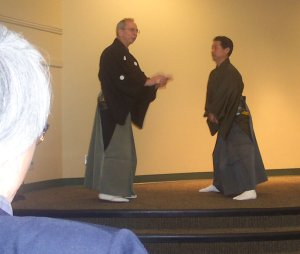 Richard Emmert and Akira Matshi in noh lecture demonstration